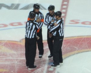 NHL Referees Preparing for the PreSeason Game at the Scotiabank Saddledome 2011