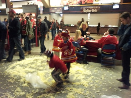 Popcorn falling ontop of kids wearing Flames Jerseys at after the Calgary Flames Game
