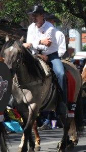 Calgary Flames Derek Smith riding in the 2013 Calgary Stampede